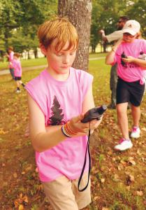 Brilliant sixth-graders Braden Tucker (front) and Gracie Mays navigate GPS coordinates.