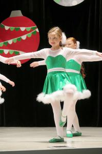 "Caroline Bentley performs ""We Are Santa's Elves.""(From left) Tucker Riddle, Alexa Cantrell and Michan Green of Alysse Nicolle's School of the Arts perform ""Rudolph the Red Nose Reindeer."""